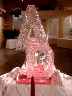Hand carved letters with a red light steals the show from Louisville Ice Sculptures. Price $275