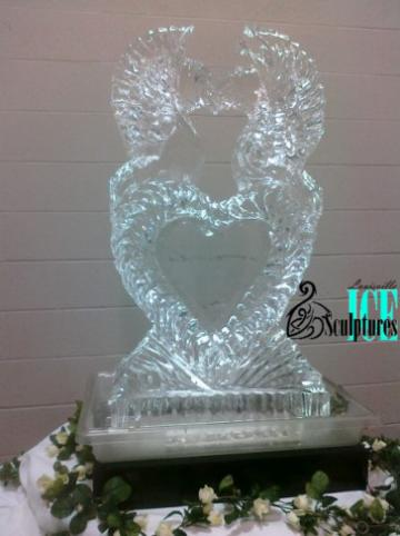 A lovely ice sculpture with a heart surrounded with seahorses that was created by Louisville Ice Sculptures  is a beautiful addition to an event. Price $325